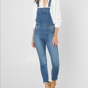 Free people mid rise skinny denim overalls